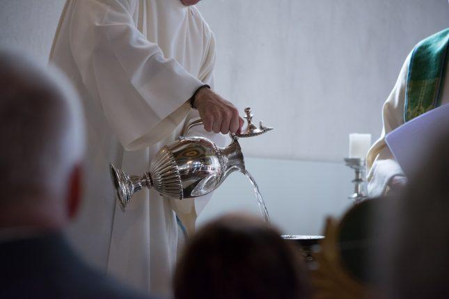qui peut offrir une médaille de baptême